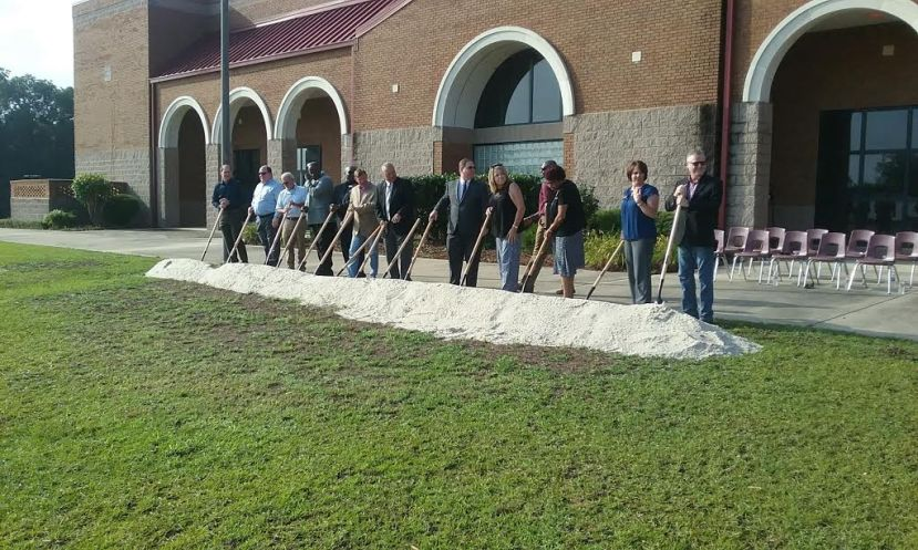 Coffee School System officials break ground for the new Performing Arts Center earlier this week.