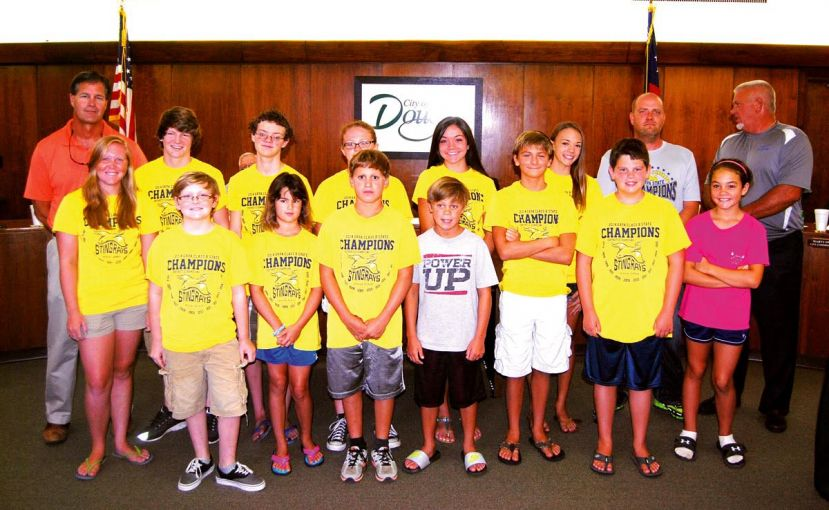 Members of the state champion Douglas Stingrays swim team visited the City Commission meeting Monday night.