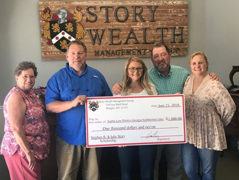 Sophia Winters (center) has received the Story family scholarship for 2018.