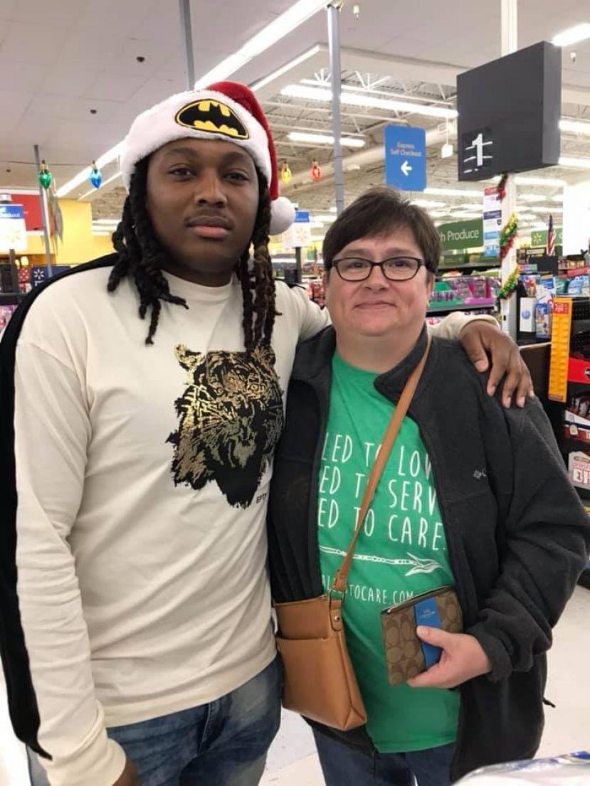 Keenan Webb, known by his stage name DJ Suede, and Tammy Leggett stand together Thursday at Wal-Mart in Douglas after Keenan paid Tammy's bill at checkout.