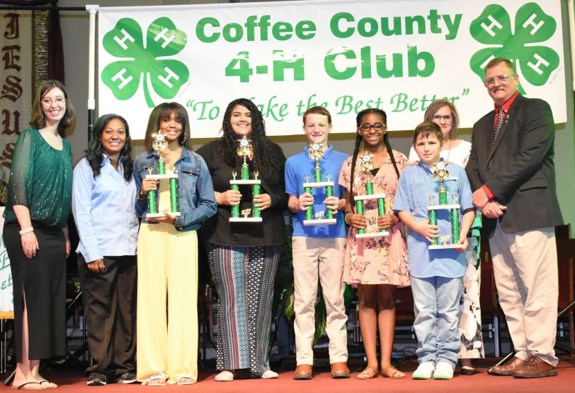 Outstanding 4-H Member Award Recipients and 4-H staff at 4-H Honors Night. (L to R): Alyse Hall, 4-H Program Assistant, Chalanda Woods, AmeriCorps Member, Sariah Wells, Savannah Cothern, Glenn O'Steen, Ariyah Scott, Aaron Chaney, Liz Batten, 4-H Program Assistant, and Kevin Tatum, County Extension Coordinator. Not pictured: Kayden Davis, Kilee Davis, and May Belle Davis.