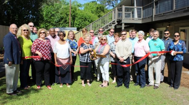 Two sisters cut ribbon for Executive Lofts