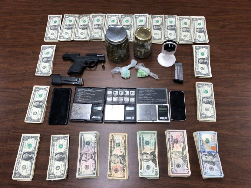 DPD finds illegal drugs, gun, and money in home