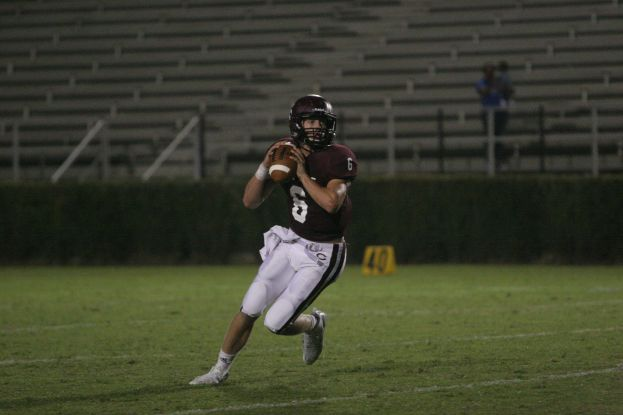 Coffee quarterback Max Hughes, seen here against Savannah earlier this year, guided the Trojans to a 40-0 win and a region championship Friday night.