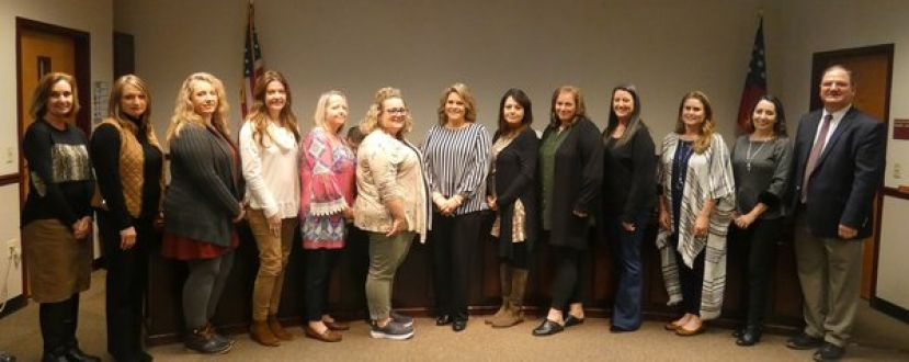 Several of the Nicholls Elementary staff were present at the recent January 23 school board meeting for recognition of their award.  From left to right:  Debbie Reed, Media Specialist; Pam Elrod, Assistant Principal for Instruction; Jennifer Wilcox, School Counselor; Stacy Boggs, 3rd Grade teacher; Lisa Edge, 2nd Grade teacher; Nichole Dale, 1st Grade Teacher; Gina Thomas, Kindergarten Teacher; Alisa Kirkland, Academic Coach; Jeanette Perry, 4th Grade Teacher; Kristen Hutchison, Pre-K Paraprofessional; Suzanne Harper, 5th Grade Teacher and Lori Bratcher, Principal of Nicholls Elementary.