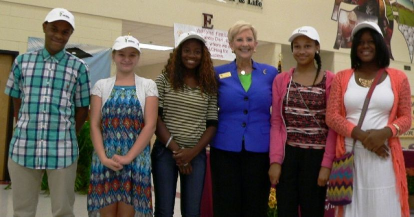 Georgia First Lady Sandra Deal congratulates five Coffee County Middle School students recently named as REACH scholars.