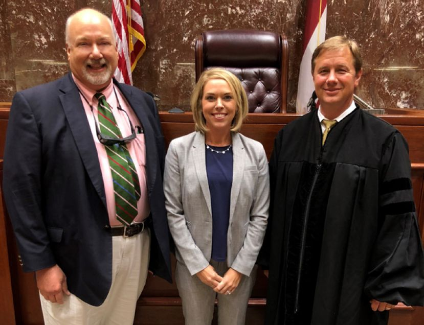 Bennett (center) is joined by Superior Court Judge Jeffrey H. Kight (right) and District Attorney George E. Barnhill (left) just after she was sworn in to serve as an Assistant District Attorney in the Waycross Circuit on September 19, 2018 at the Ware County Courthouse.