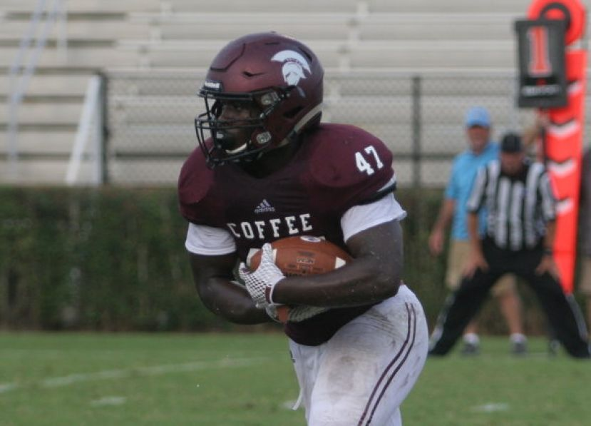 Coffee's Jameon Gaskin, seen above in a game from earlier this season, scored three touchdowns in the Trojans' 52-49 loss to the Warner Robins Demons. Dalrone Donaldson caught three touchdown passes from quarterback Wade Sumner and Jarquavious Jefferson added another score on an interception return for a touchdown as well.