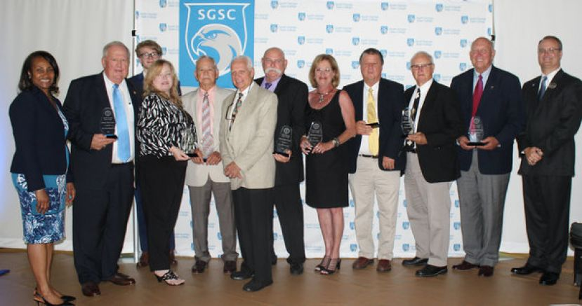 (L to R) Dr. Ingrid Thompson-Sellers, SGSC president, Mr. Peter Bragan, Jr., Ms. Lynn Pesic – daughter of Mr. Victor Spooner, Jr., Mr. Nicholas Pesic – grandson of Mr. Victor Spooner, Jr., Mr. Kelton Cook, Mr. Ron Kelley, Mr. Steve Foucault, Mrs. Lynn Childers, wife of late Mr. Terry Childers, Mr. Scott Sims, Mr. Howard Ray, Mr. Larry Guest and Dr. Greg Tanner, SGSC Dean of Students