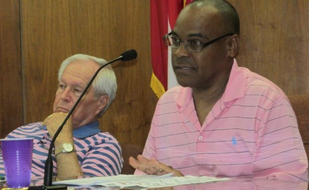 City Commissioner Marty Swain, right, addresses the audience during the regular meeting of the Douglas City Commission Thursday, June 26. Commissioner Bob Moore is pictured at left.
