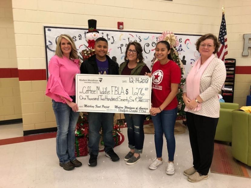 Pictured left to right: AP of Instruction Vette Lott, Coffee Middle FBLA Vice President Josiah Brockington, Heather Stodghill, FBLA Adviser, Coffee Middle FBLA President Joana Mazariegos, and Beth Wright from Modern Woodmen.