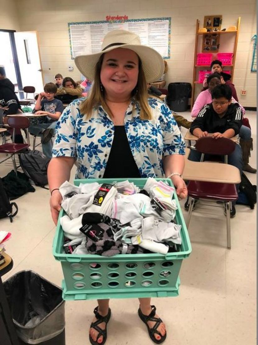 Mrs. Whitley with basket of socks for nursing home