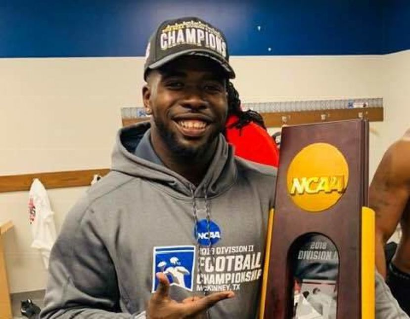 Valdosta State linebacker Jameon Gaskin displays the Division II National Championship trophy following VSU's win over Ferris State University Saturday afternoon.