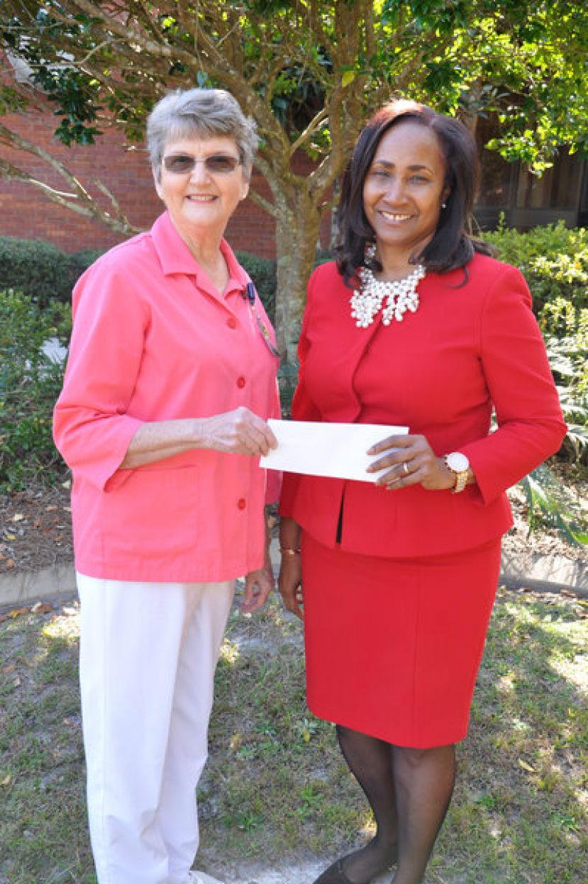 Reba Quirk (left), president of the Memorial Satilla Health (MSH) Auxiliary, made a significant contribution recently on behalf of the organization to the Memorial Satilla Health Auxiliary Endowment Scholarship at South Georgia State College (SGSC)