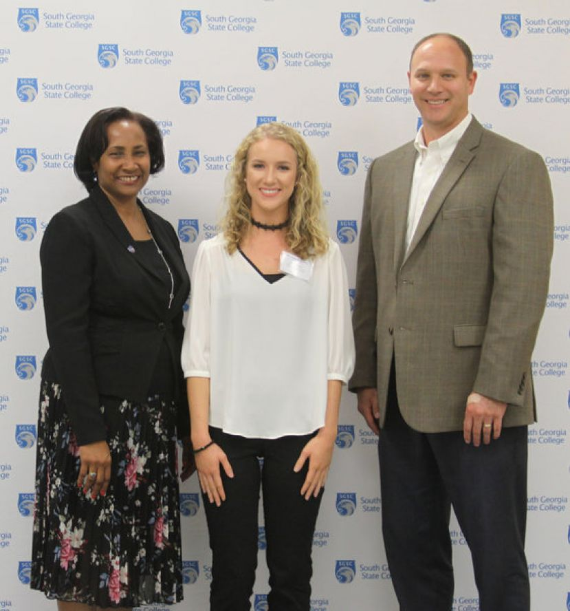 SGSC President Dr. Ingrid Thompson-Sellers and SGSC Foundation President Chris Tuten congratulates Allie Morgan (center) of Ambrose, Ga., on receiving a 2017 foundation scholarship last year