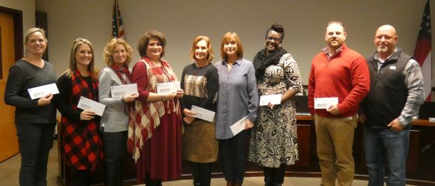 Those who were able to attend the meeting and receive the checks for their schools were: From left to right: Terry Day, media specialist at Ambrose Elementary; Kelli Ragle, media specialist at Broxton Elementary; Angelina Koster, media specialist at Eastside Elementary; Tamera Morgan, principal at Indian Creek Elementary; Debbie Reed, media specialist at Nicholls; Ellen Pope, media specialist at Satilla; Nakenze Jordan, media specialist at Westside Elementary; Alan Chancey, principal at Westgreen Elementary; Andy Varnadore, representative of Satilla REMC.