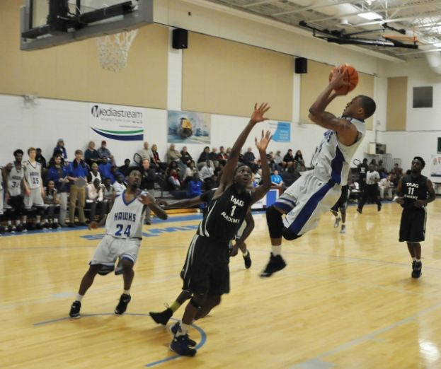 Jovante' Spivey pulls up for a shot against TAAG Academy Tuesday night.