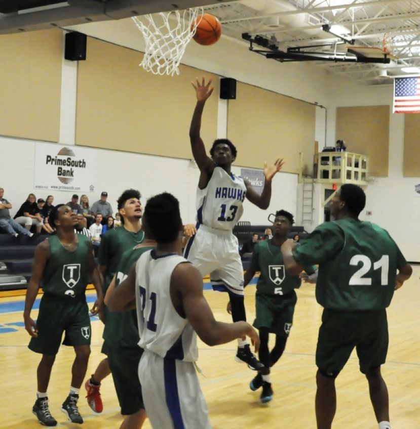 Dunovon Robinson scores two of his eight points against TAAG Academy.