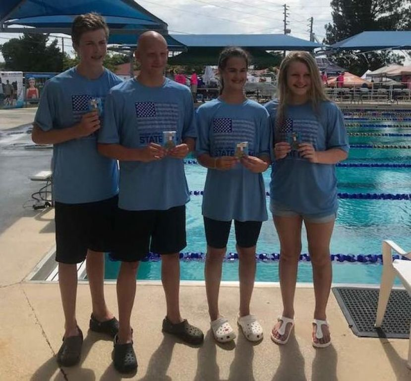 From left: The state champion 13-14 200 mixed free relay team: Jon Vickers, Ben Gowen, Maggie Minchew, and Loren O'Steen.