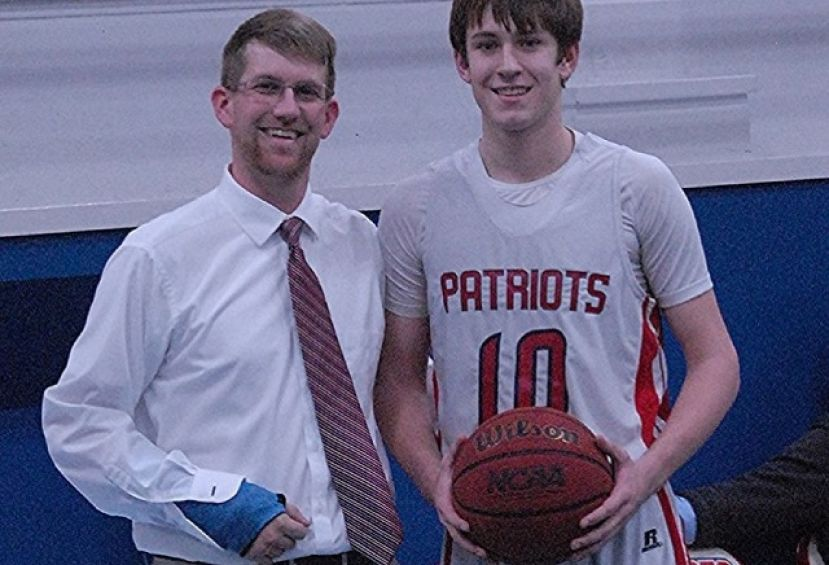 Dalton Wilkes, pictured with CCA Patriots head coach Daniel Hannah, scored his 1000th career point today in the Patriots' regular season finale.