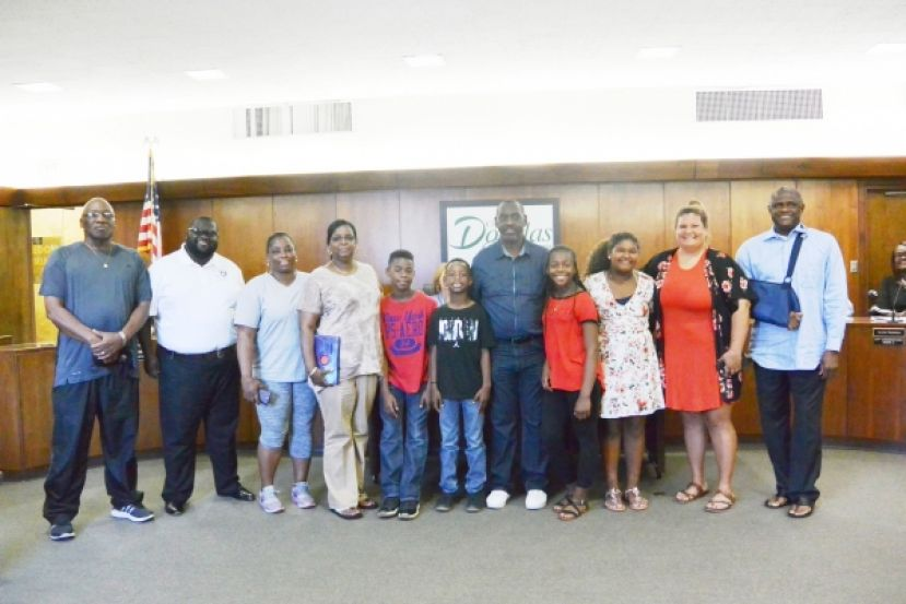Pictured: Calvin Smith, Mayor Pro Tem Kentaiwon Durham, Tonya Gilbert, Brenda Smith, Tyrese Woodgett, Tyrese Smith, Ronnie Graham (Coach), Tyrianna Woodgett, Jada Robinson, Janice Savage, Mayor Tony Paulk and the parents of the team members.  Not pictured are: Aria Paulk, Nevin Swanson, Jeremiah Bazell