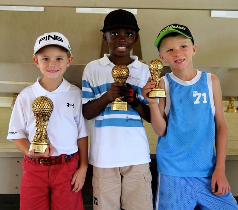 Pictured left to right, Ben Fussell, Javon Mizell, and Billy Roberts display their trophies for first, second, and third place finishes during the GRPA's state golf tournament last week in Dalton.