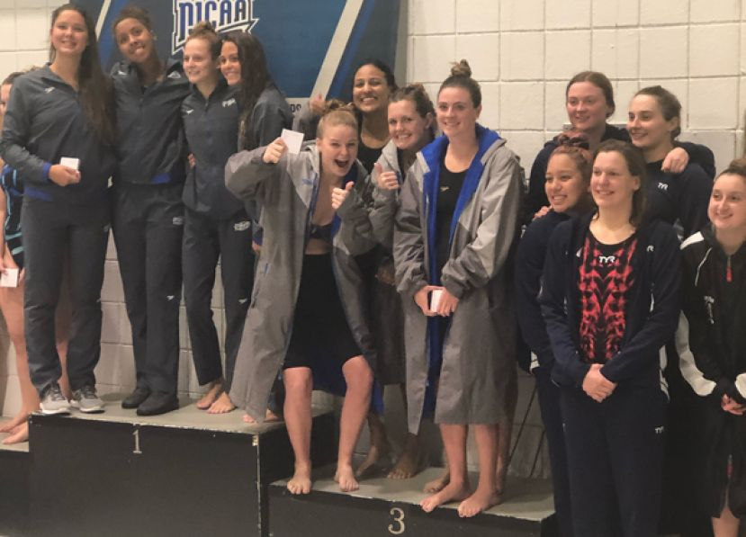 Casey Hall, Jessilyn Graham, Abigail Aldridge, and Megan Harrell take the third place spot on the podium in the 400 medley relay at the NJCAA national swim meet in Buffalo, New York.