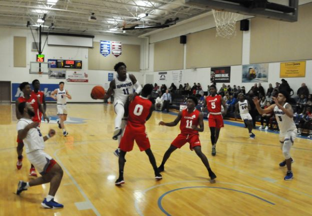 Marquise Jackson leads a fast break Tuesday night against Core4 Academy.