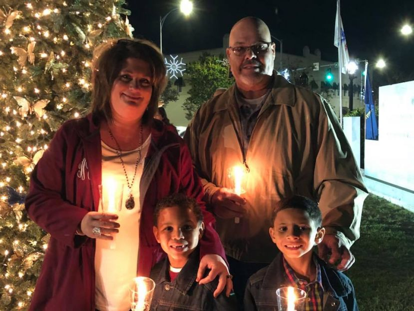 Tamara and Terry Morgan stand with their children Ashton (left) and Lee (right) at the tree lighting ceremony Tuesday night. Ashton is currently undergoing treatment for medulloblastoma, a life-threatening form of brain cancer.