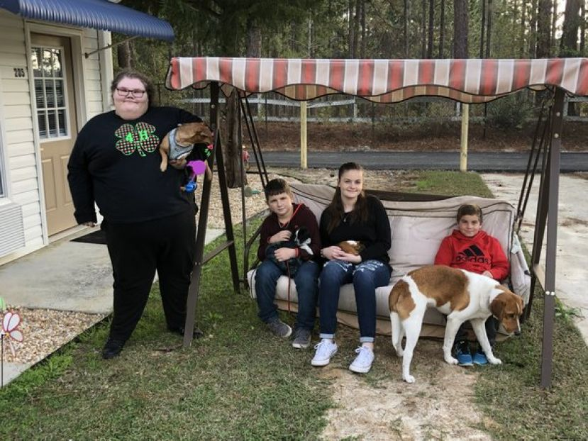 4-H members Kimberly Wright, Aaron Chaney, Natalie Newell, and Justin Burkett share their pets with residents of The Landings for 4-H Pet Therapy Visitation.