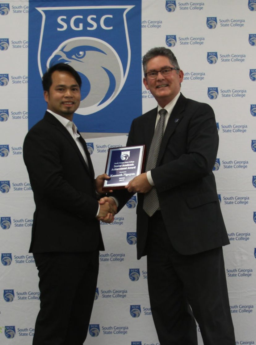Kenneth Nguyen (left) of Douglas, Ga. was recipient of two awards during the annual Honors Night Ceremony on South Georgia State College's Douglas Campus. Dr. Robert Page, vice president for academic affairs, congratulated Nguyen for his accomplishments.