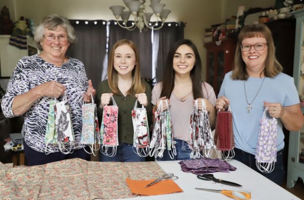 AngieAtkinson, Myrtle Chaney, and Angie's two daughters, Alana, and Leana, have sewed hundreds of masks for people all over the country as a result of the COVID-19 outbreak.