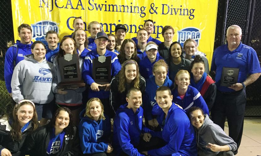 The SGSC swim teams celebrate their runner up finish at the NJCAA national championship meet in Fort Pierce, Fla., as head coach CM Jenkins displays his women's national coach of the year award.