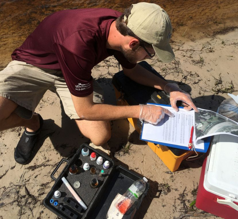 Tyler Fitzgerald, Satilla Riverkeeper's water quality monitoring intern, samples water at Warner's Landing.