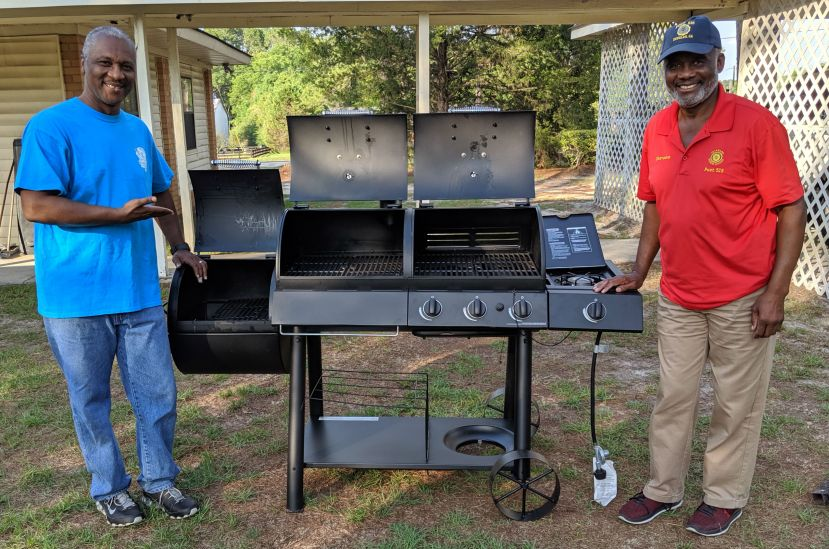 Carl Wilkerson (left) shows off the grill his wife, Tammy, won in the American Legion Post 515 raffle held last week at Ole Times Country Buffet.