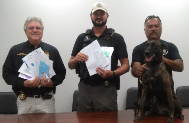 Pictured, left to right, are Coffee County Sheriff Doyle Wooten, K-Officer Chris Rozar, A.J. Phillip, and Boo.
