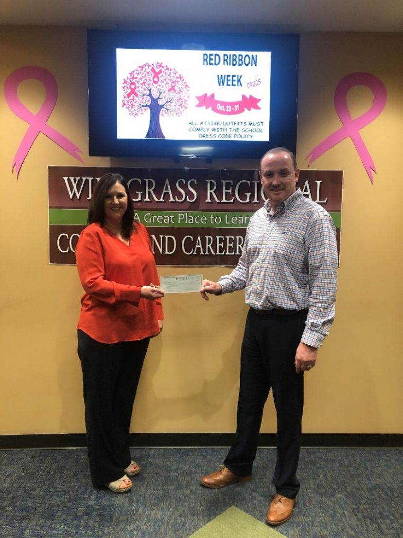 Pictured: (L-R) Pam Smith (Wiregrass Regional College & Career Academy Director) & Lee Taylor (First National Bank of Coffee County)