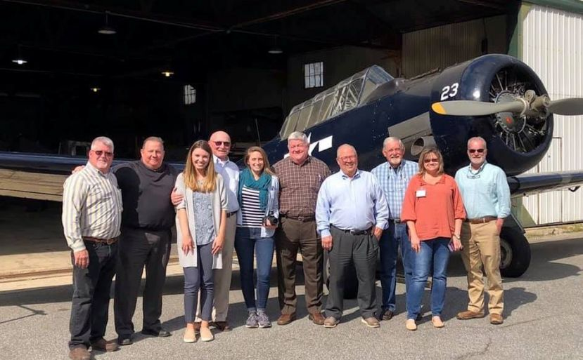 (L-R) Howard Whidden (Airport Manager), Stanley Lott (Chamber Board), Jennifer Chilton (Chamber of Commerce Tourism), Tom Smith (Airbase Preservation Committee), Kit Vinsick (Director), Don Brooks (WWII Flight Training Museum), Craig Miller (Producer), Jim Rimes (WWII Flight Training Museum), Blondale Thomas (City of Douglas), and Vic Suttles (WWII Flight Training Museum).
