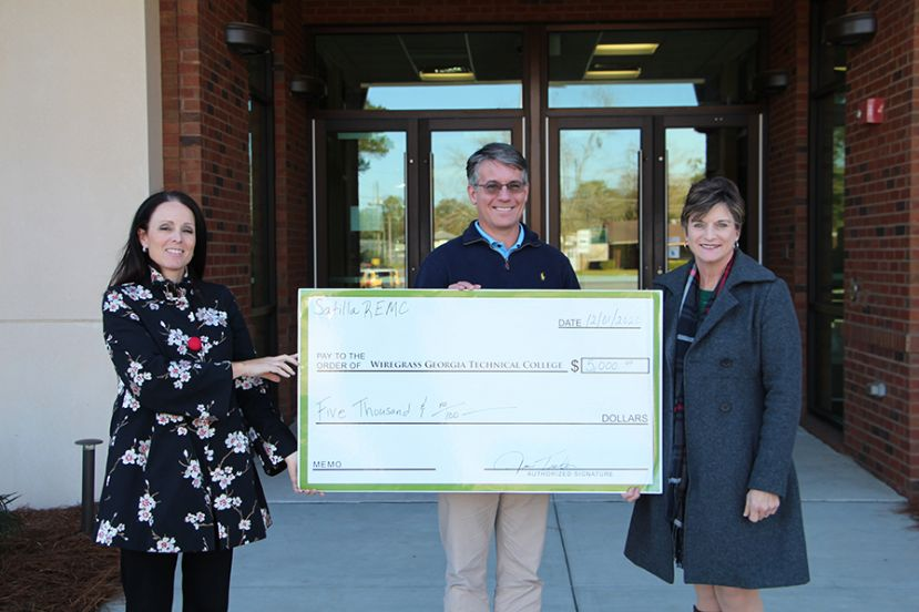 Pictured: Wiregrass Executive Director of Fundraising Crissy Staley, Customer Service Manager at Satilla REMC and the President of the Satilla REMC Foundation Jim Tucker, and Executive Director for Academic Success.