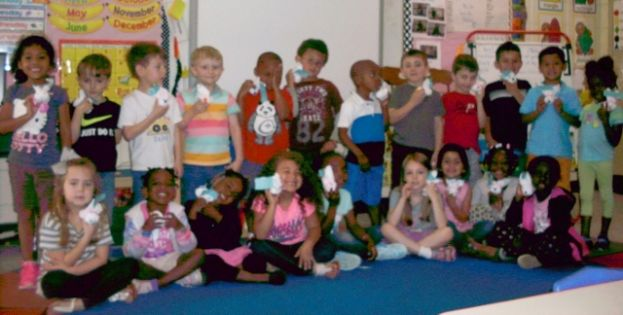 "Students in Ms. Beverly Barbaree's Class at Eastside Elementary holding up their Boo Boo Bunnies while sending a big ""Thank You"" to their new CHS friends."