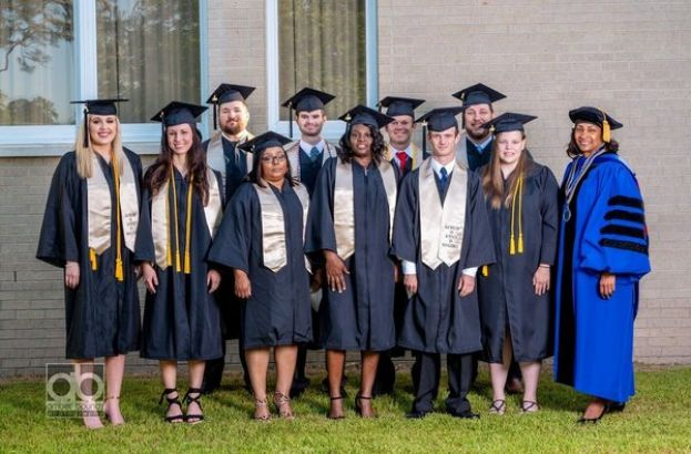 Dr. Ingrid Thompson-Sellers (far right) is shown with the first class of graduates from the Bachelor of Science in Management program. The graduates are (front row L-R) Kacee Albritton from Douglas, Ga., Callie Mikell from Alma, Ga., Toshi White from Waycross, Ga., Melissa Willliams from Hazlehurst, Ga., James Blackstock from Fitzgerald, Ga.,  Carrie Tatum from Douglas, Ga., (second row L-R) Luke Harrell from Alma, Ga., Carl Smith from Douglas, Ga., Chase Cothern from Alma, Ga., and James Whitley from Wray, Ga.