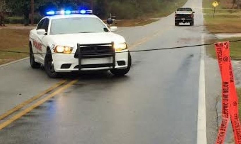 A Douglas police officer blocks East Walker Street after severe weather Sunday morning downed a power line. Another dangerous storm system is heading into Coffee County later Sunday afternoon.