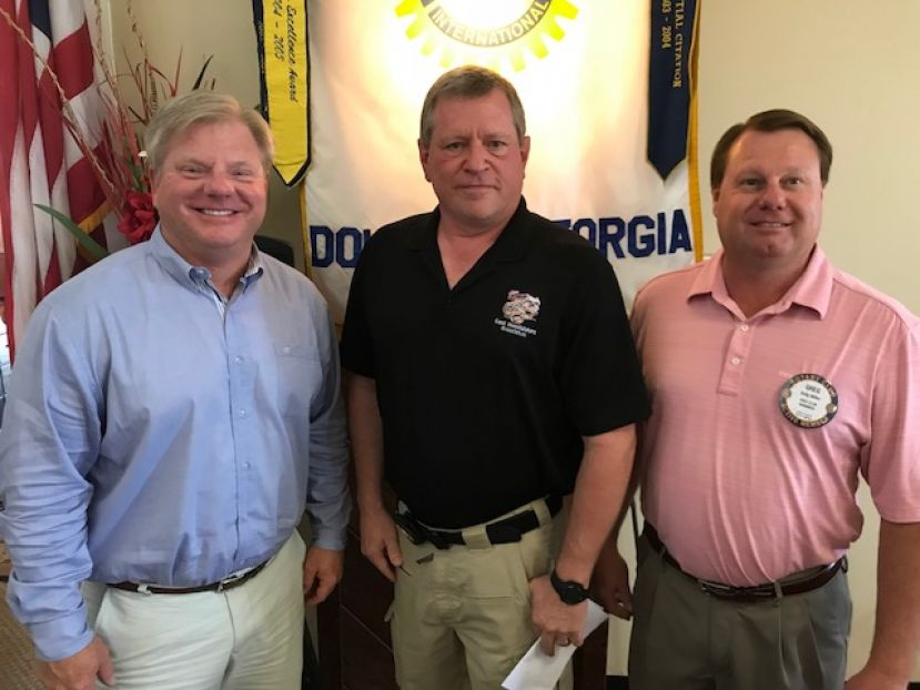 From left: Christian Taylor, Douglas Rotary Club; Walter James, Coffee County Gang Unit; and Greg Miller, Rotary President.