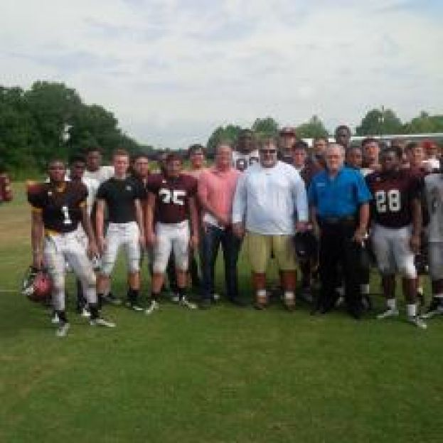 Lions Club donates to Trojans Touchdown Club
