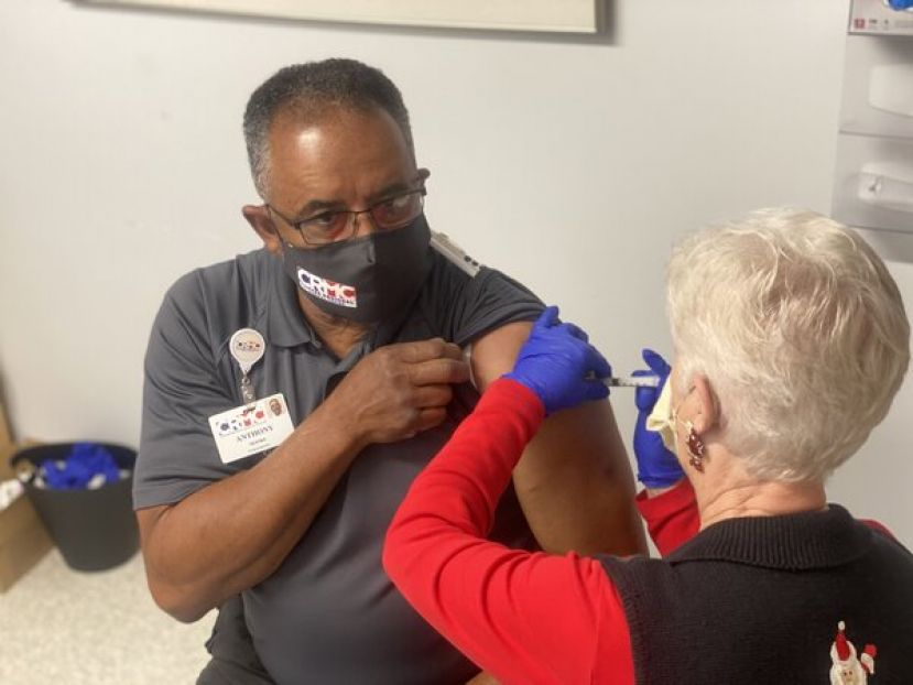 EMT Anthony Moore receives the COVID-19 vaccine at Coffee Regional Medical Center.